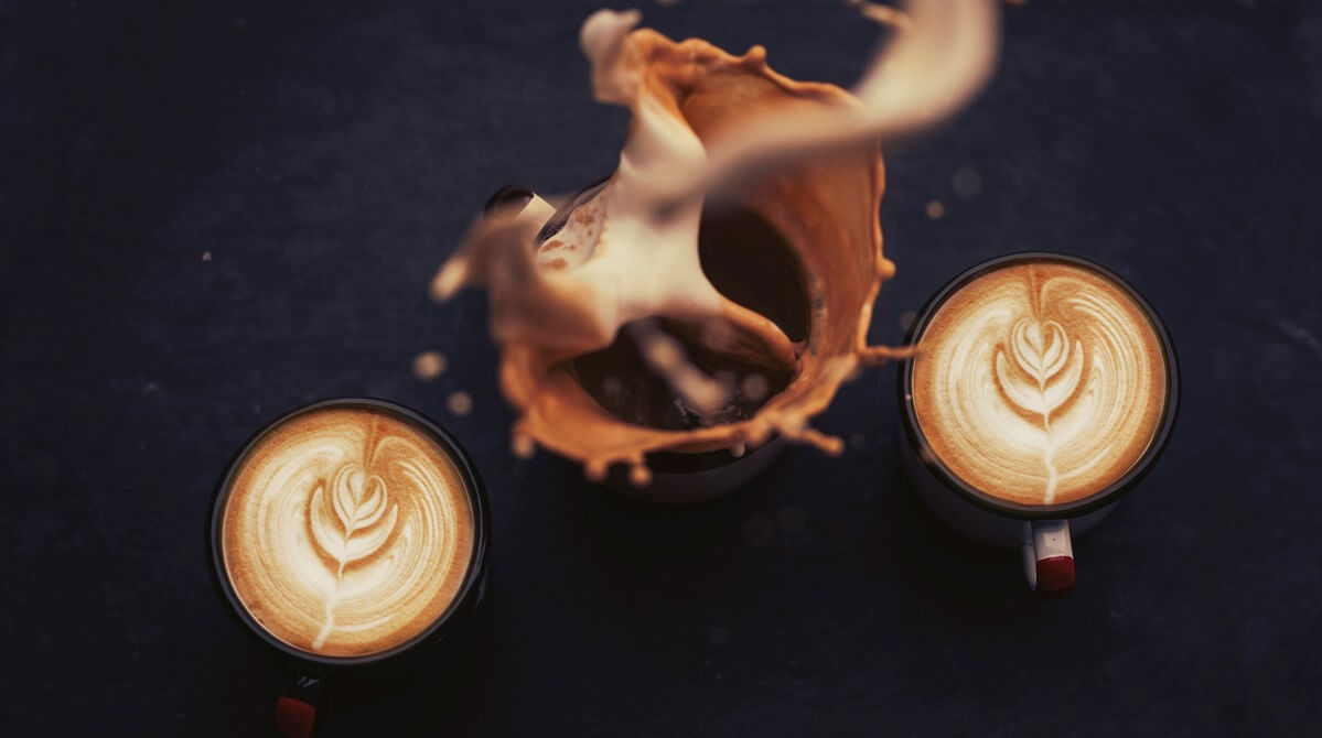 three cappuccinos latte art