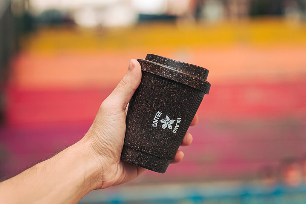 Someone holding reusable cup