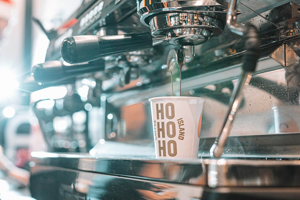 Coffee Island Christmas cup in the coffee machine