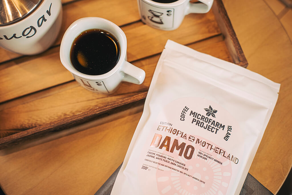 Mug and Ethiopia Damo package on a table.
