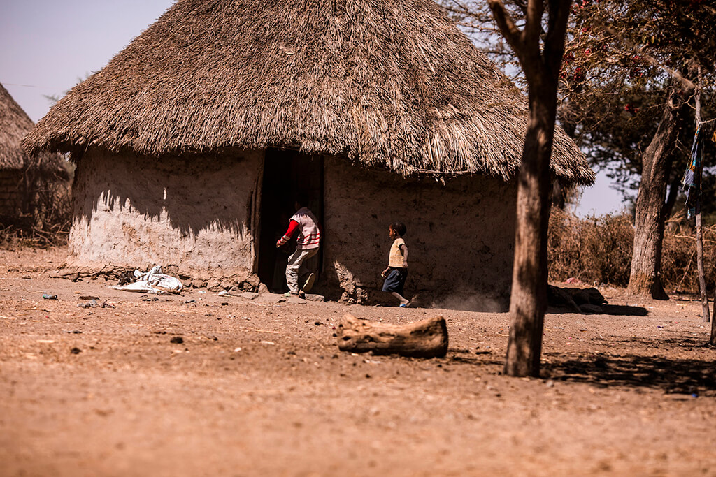 Kids playing outside a hut in Ethiopia