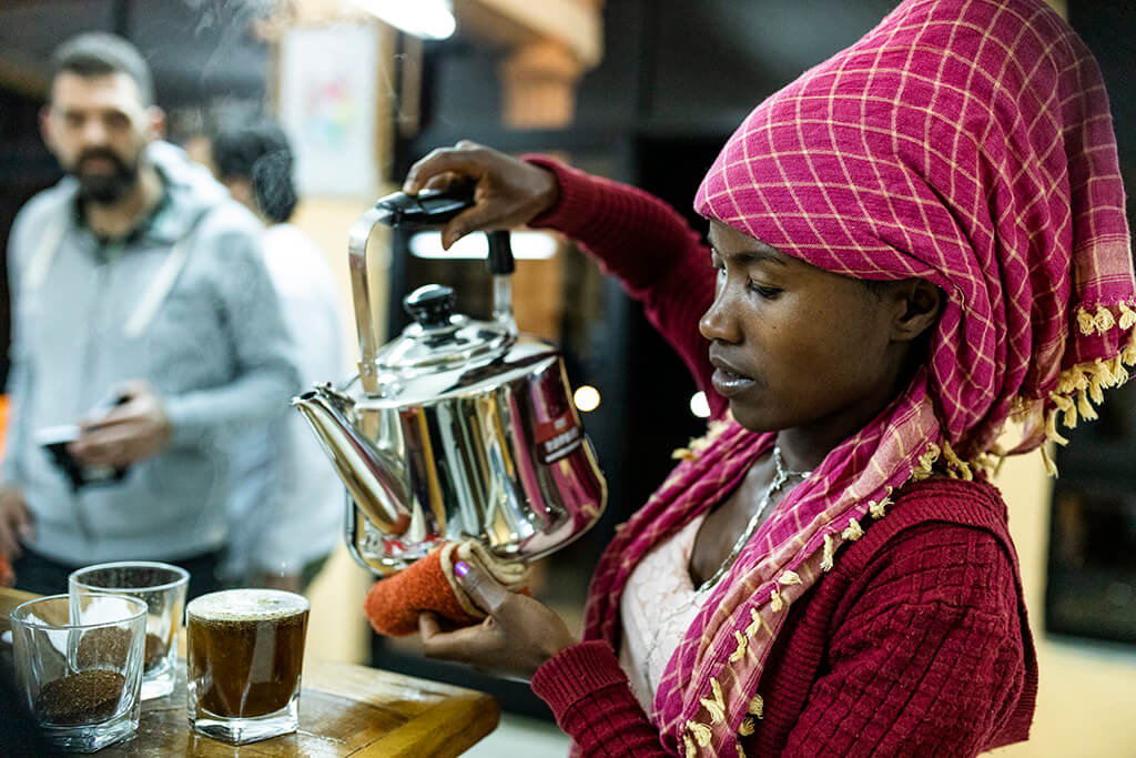 Coffee Island International Women's Day, Ethiopian woman serving coffee.