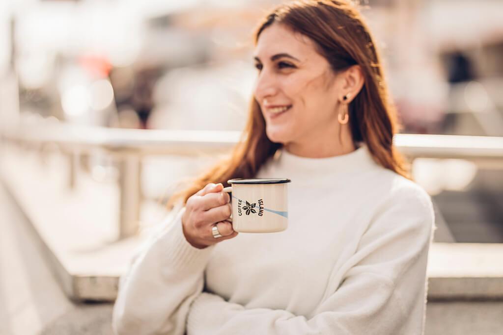 A woman enjoying her Coffee Island coffee.