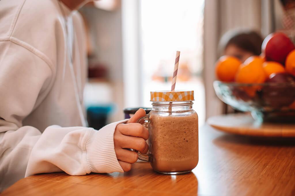 A woman enjoying her homemade Coffee Island instant coffee.