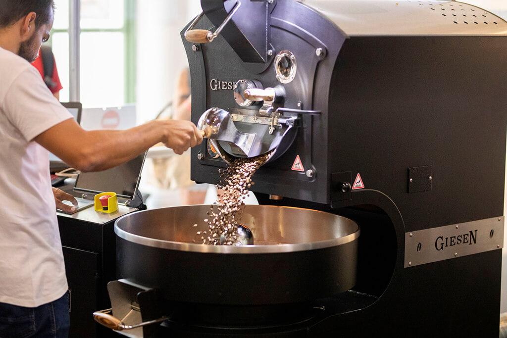 Grinding coffee by Coffee Island