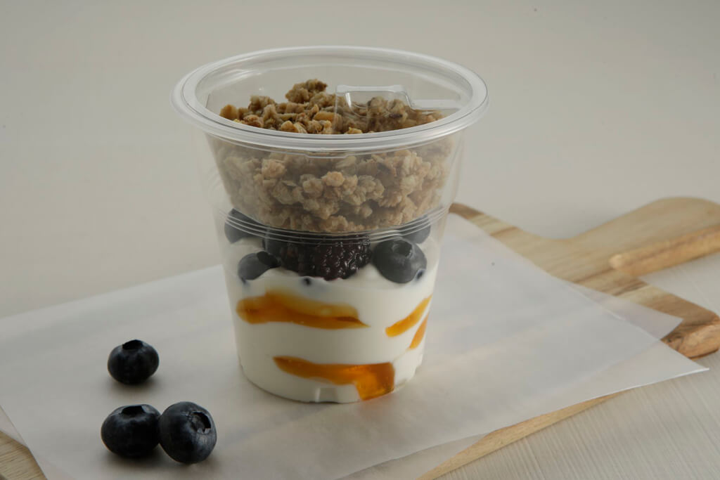 COFFEE ISLAND'S STRAINED YOGURT WITH HONEY GRANOLA AND FOREST FRUITS.