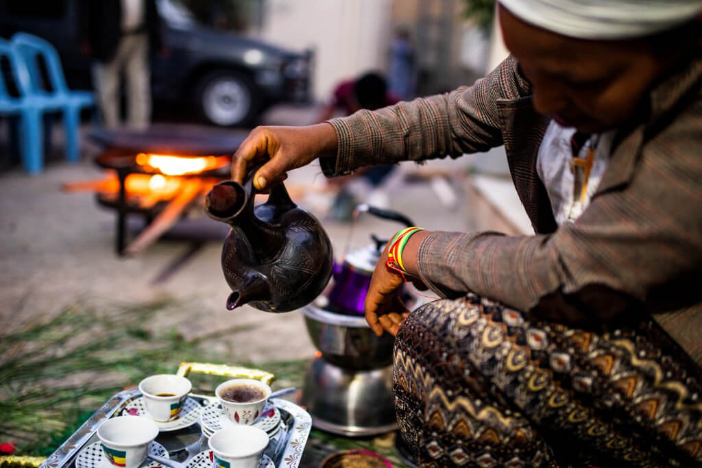 Ethiopian man serving coffee.