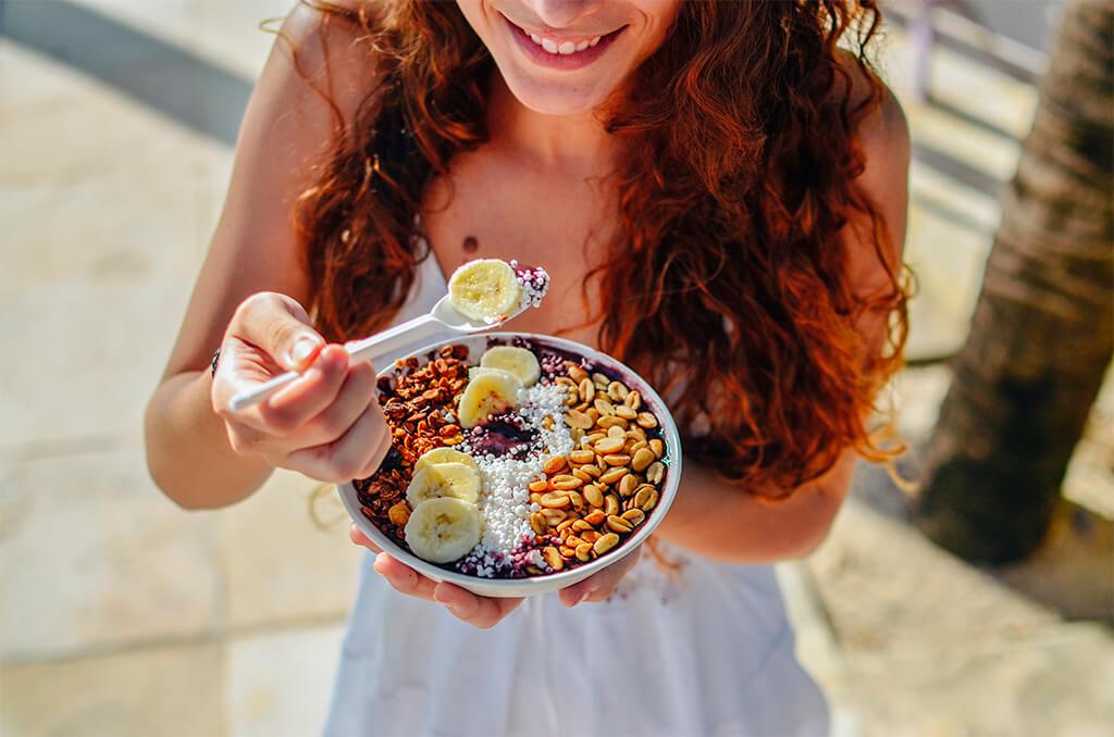 A Girl Eating her vegan acai bowl