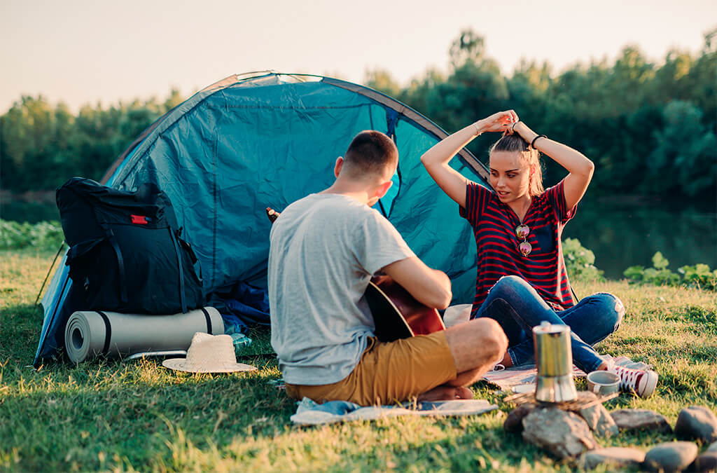 couple camping while drinking coffee